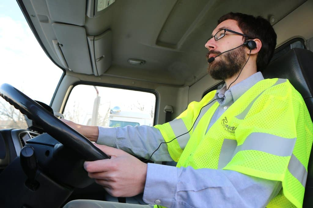 Driver using Royal Radio Headset for effective job site communication